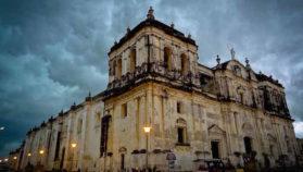White building under dark clouds in Leon Nicaragua
